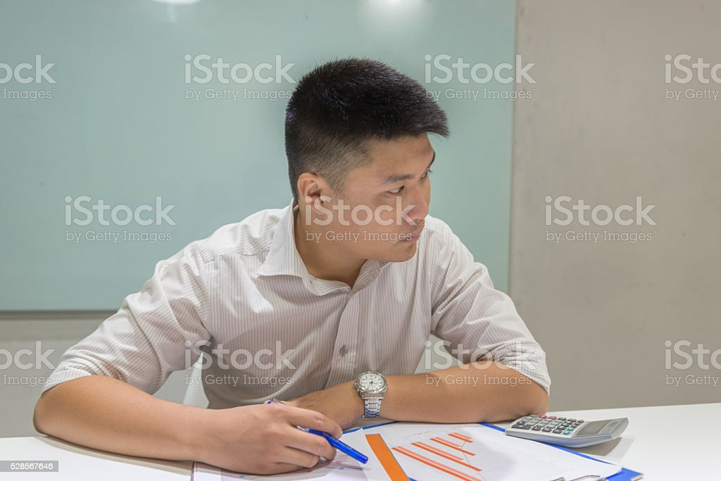 Asian businesswoman thinking about new ideas to increase sales stock photo