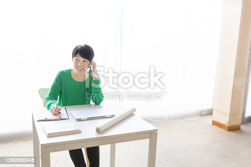 836871418 istock photo Asian businesswoman using cell phone 1086886948
