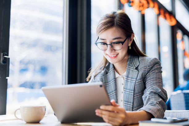 Asian Businesswoman using digital tablet. stock photo