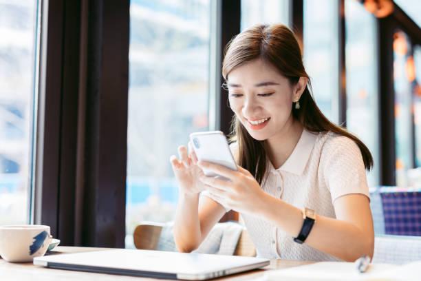 Asian Businesswoman using mobile phone. stock photo