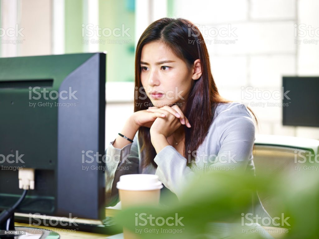 asian businesswoman working in office stock photo