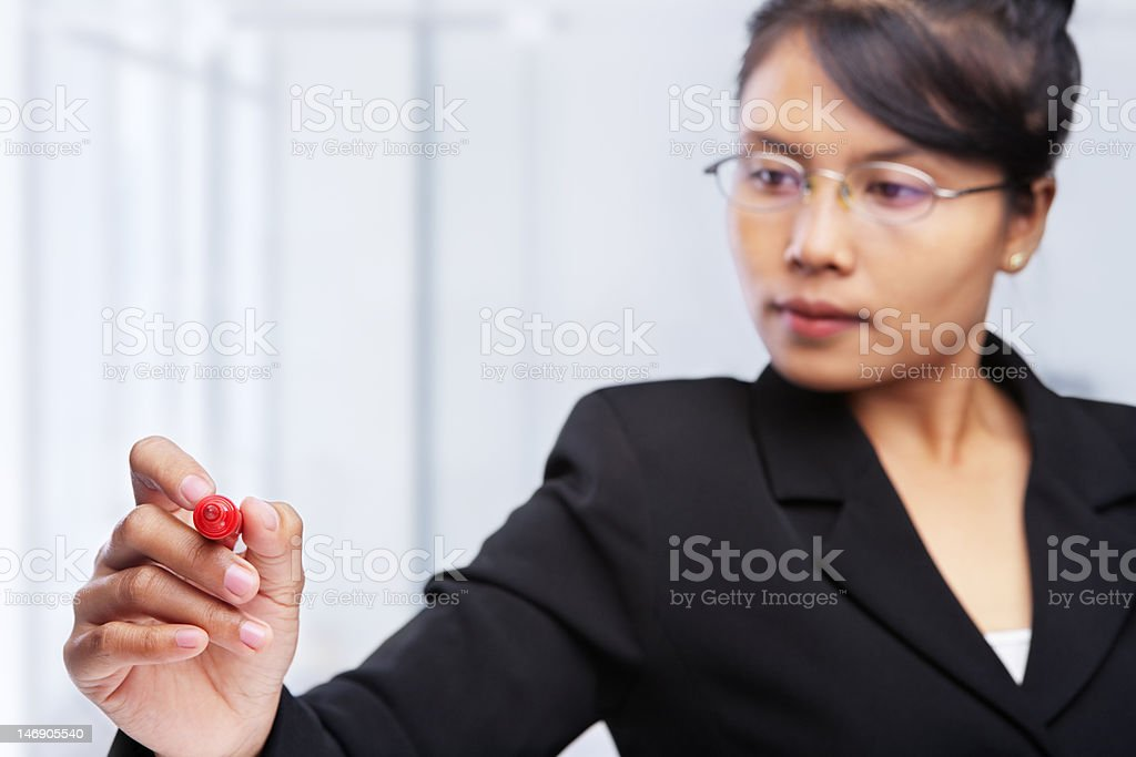 Asian businesswoman writing on glass board. stock photo