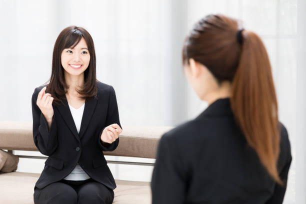 asian businesswomen working in office stock photo