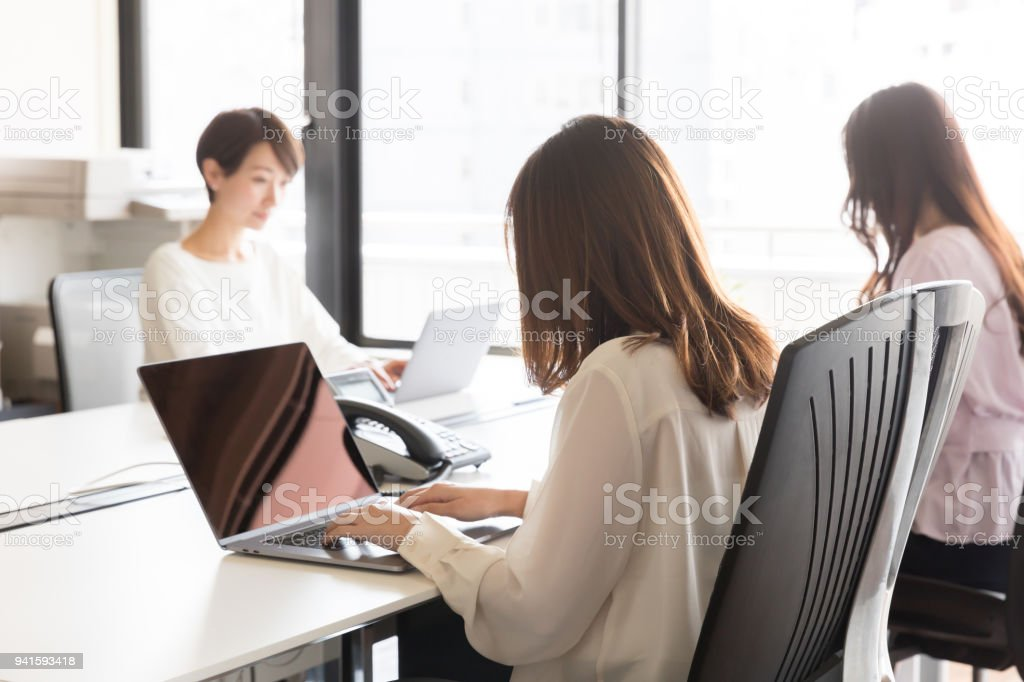 asian businesswomen working in office stock photo