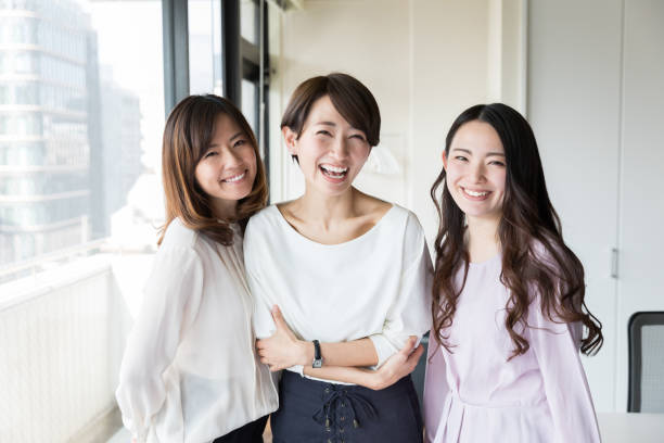 asian businesswomen working in office asian businesswomen working in office japanese ethnicity stock pictures, royalty-free photos & images