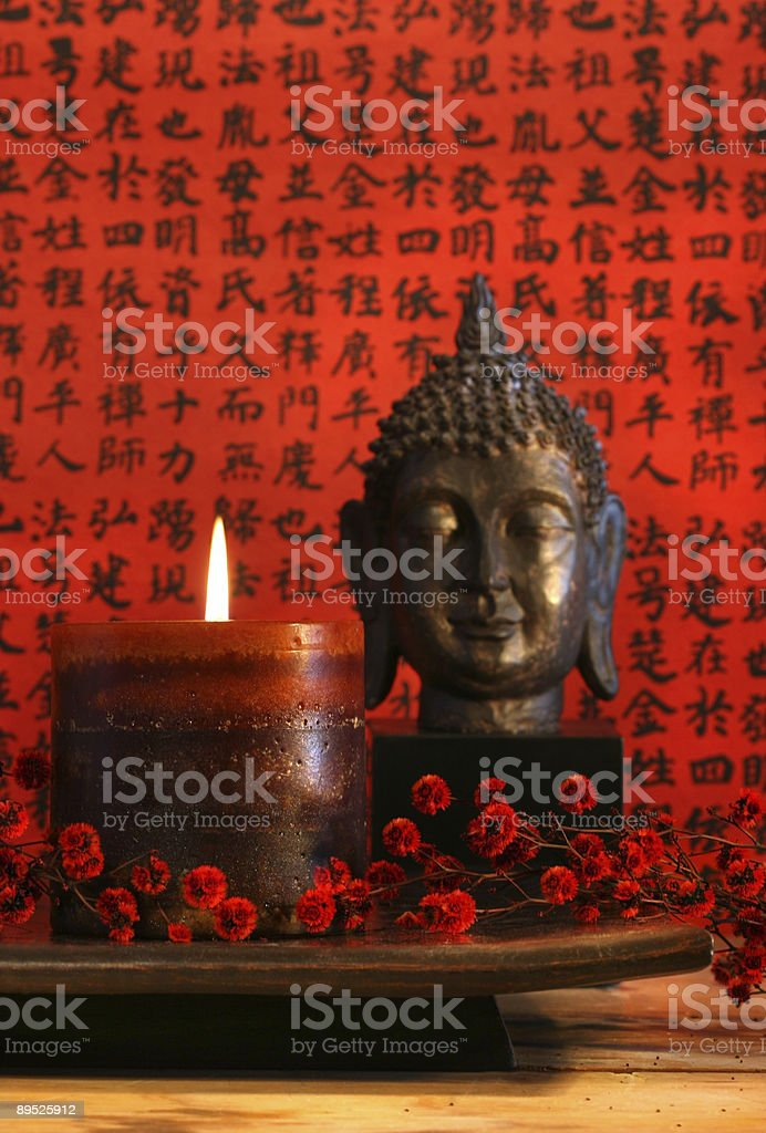 Asian candle with red oriental background royalty-free stock photo