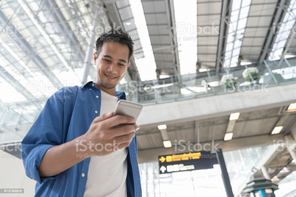 Asian casual smart man lifestyle using mobile phone connection concept. At airport. stock photo