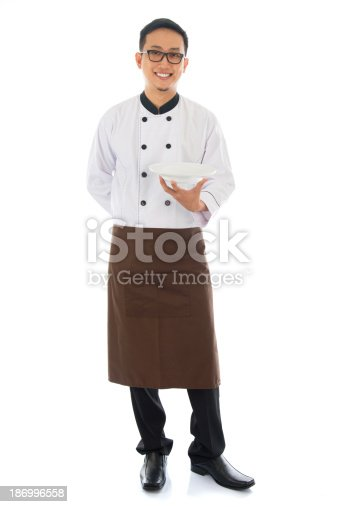 istock Asian chef holding an empty plate 186996558