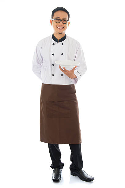 Asian chef holding an empty plate stock photo