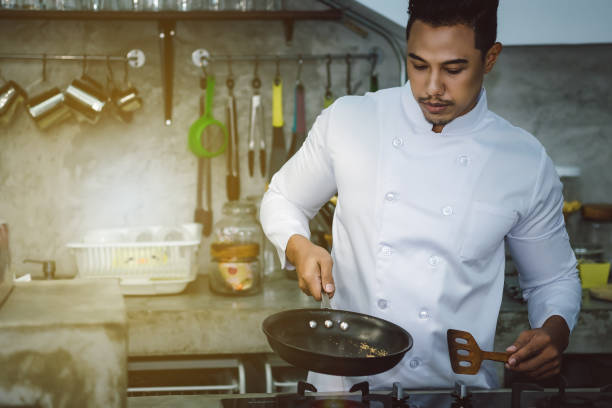Asian chefs, cooking to be delicious and skilled. stock photo