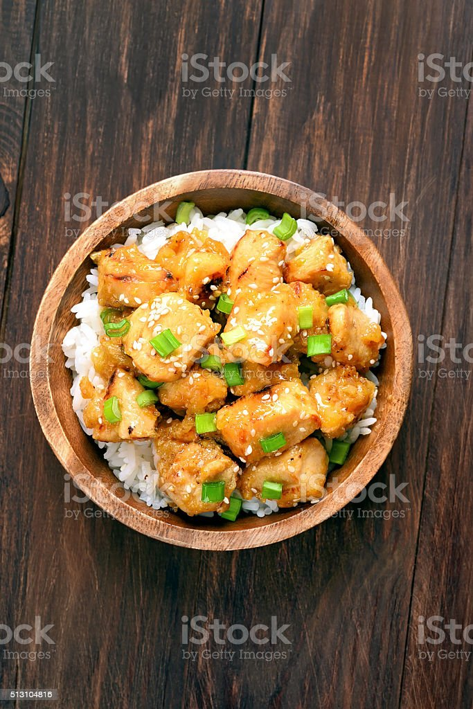 Asian chicken meat with orange sauce stock photo