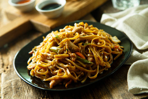 Asian chicken noodles with vegetables stock photo