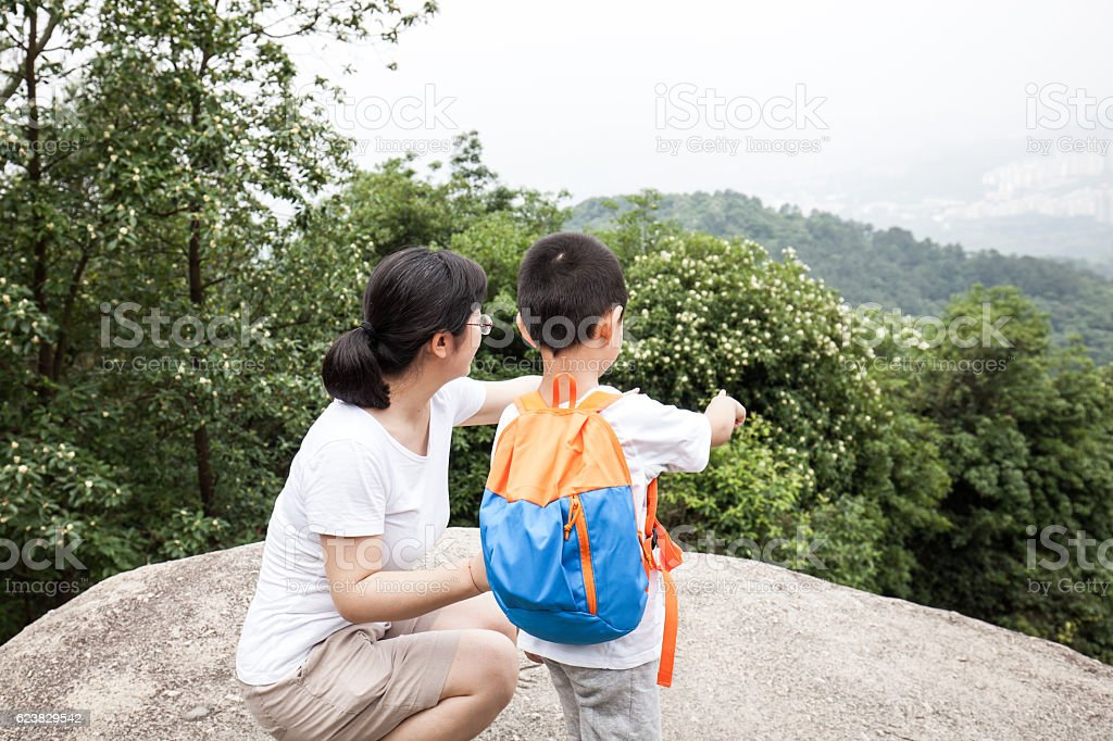 Asian child and mother pointing to the distance stock photo
