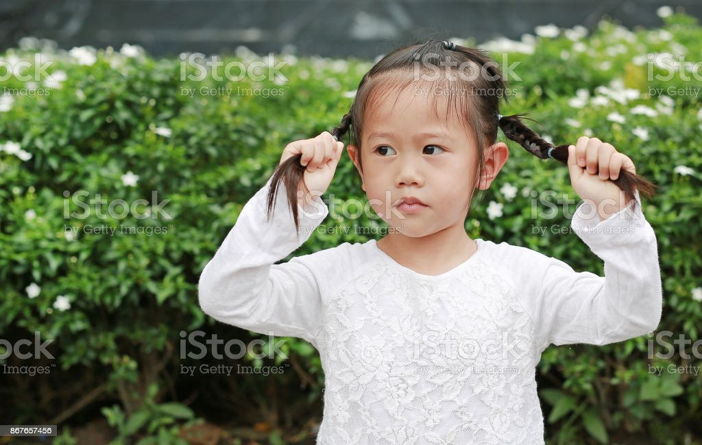 Asian Child Girl Holding Her Pigtails Hair Her Hair Is Tied