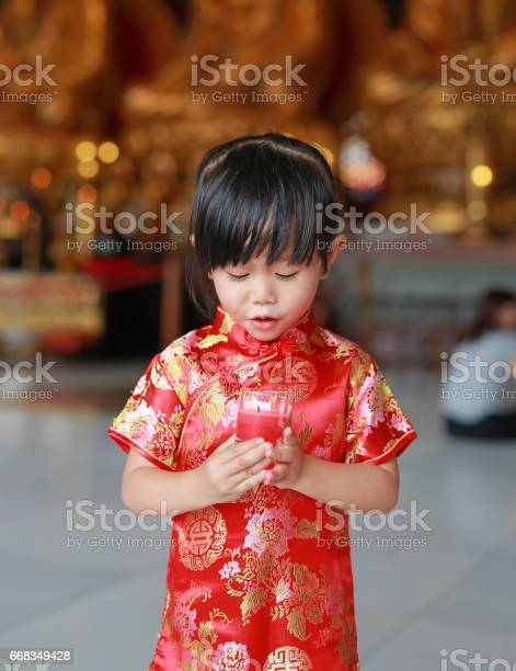 Asian child girl in traditional dress light the worship candles picture id668349428?b=1&k=6&m=668349428&s=612x612&h=gg5jgei4 i7gnulgnf0hohhmg0qwt sned1z3 v1e2u=