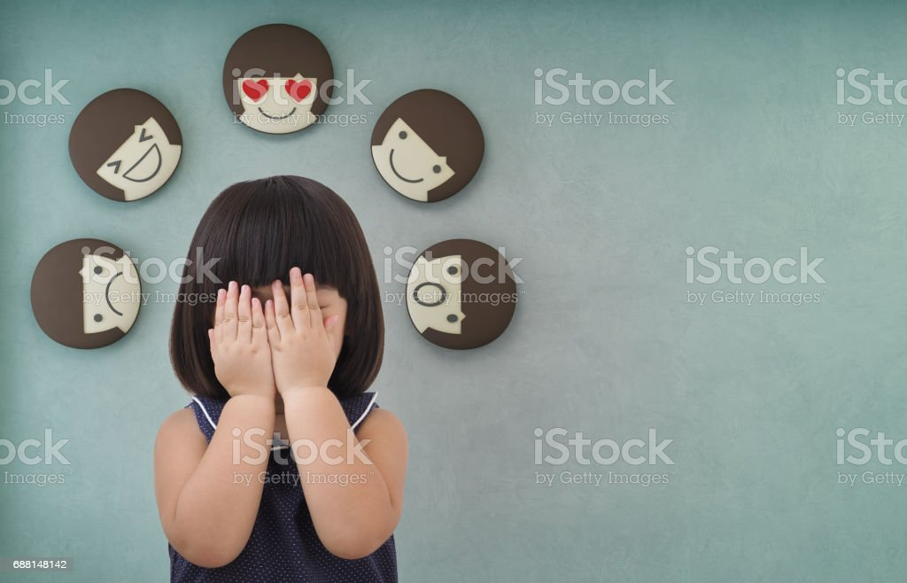 Asian child girl with green concrete wall background, Feelings and emotions of kid stock photo