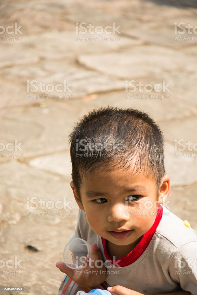 Asian child hold the feeding bottle is sitting, selective focus royalty-free stock photo