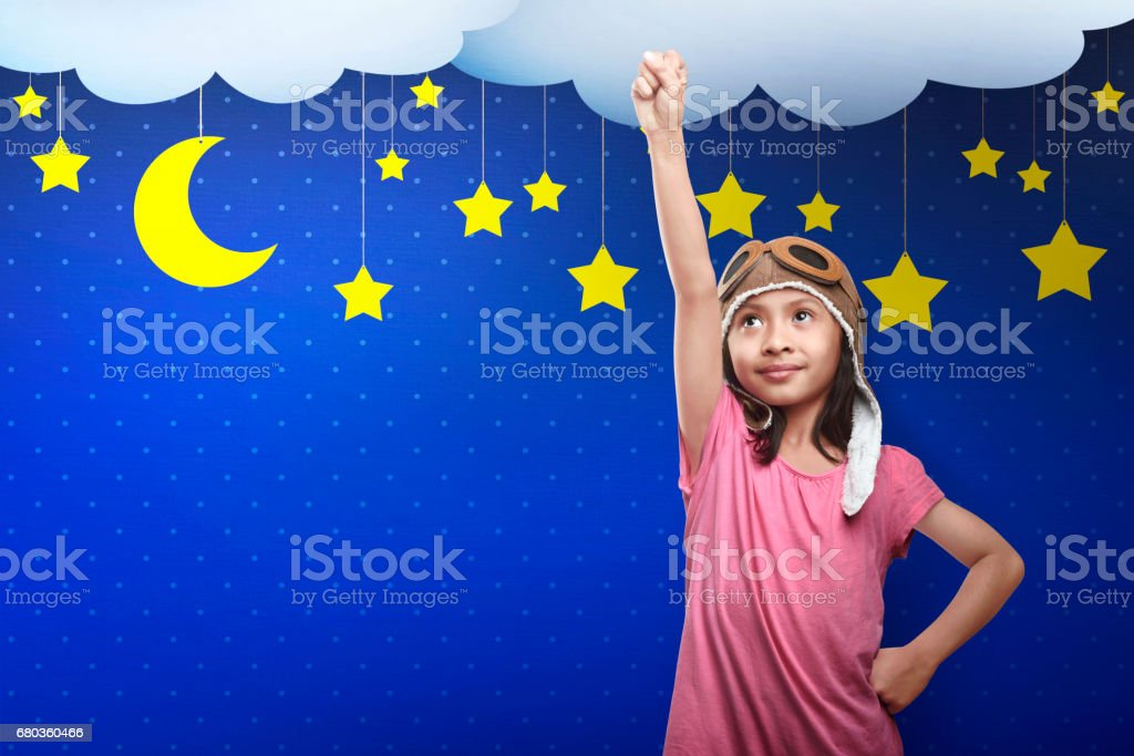Asian child in astronaut costume dreaming of becoming a spaceman royalty-free stock photo