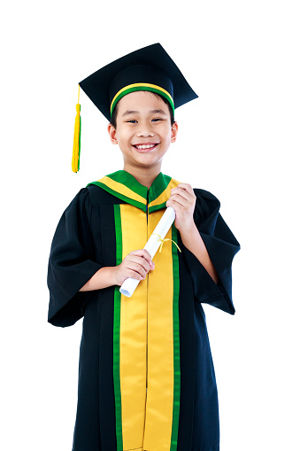 A happy young kid graduating from school