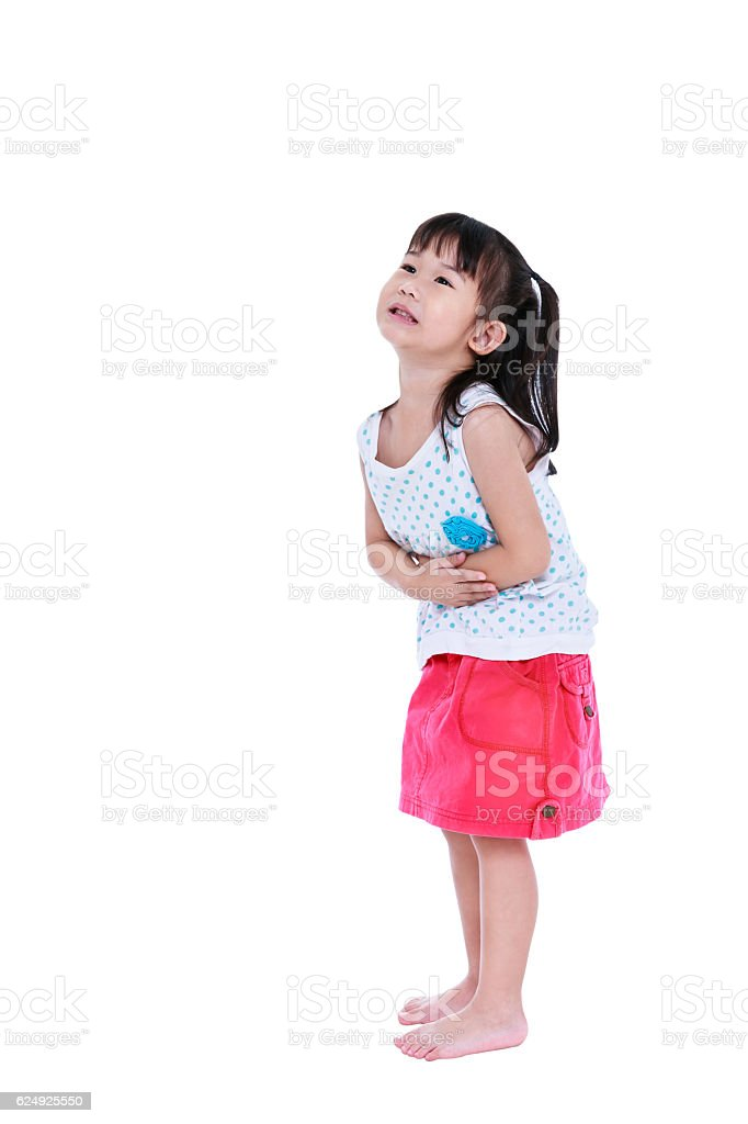 Asian child in pink skirt suffering from stomachache. Isolated o stock photo