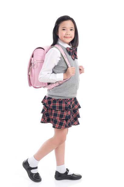 Asian child in school uniform with pink school bag on stock photo