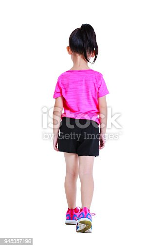 istock Asian child in sportswear back walking. Isolated on white background. 945357196