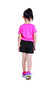 Back view. Full body of adorable asian child in sportswear back walking at studio. Isolated on white background.