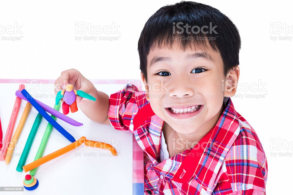 Asian child show his works from clay, on white background. stock photo