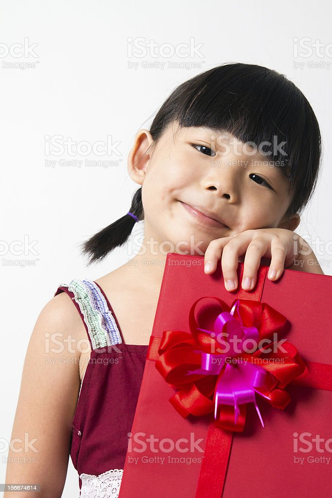 Asian child with red gift box royalty-free stock photo