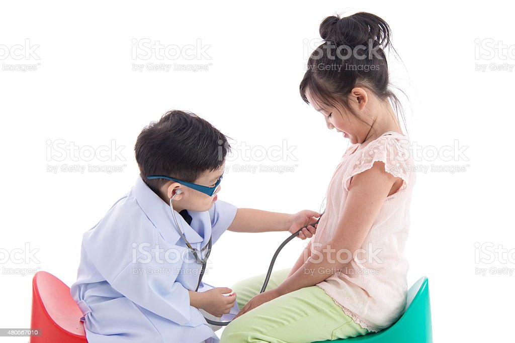 Asian children playing as doctor and patient stock photo