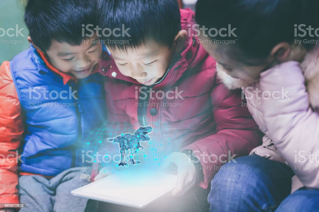 Asian children playing with digital tablet stock photo