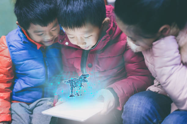 asian children playing with digital tablet - augmented reality stock photos and pictures