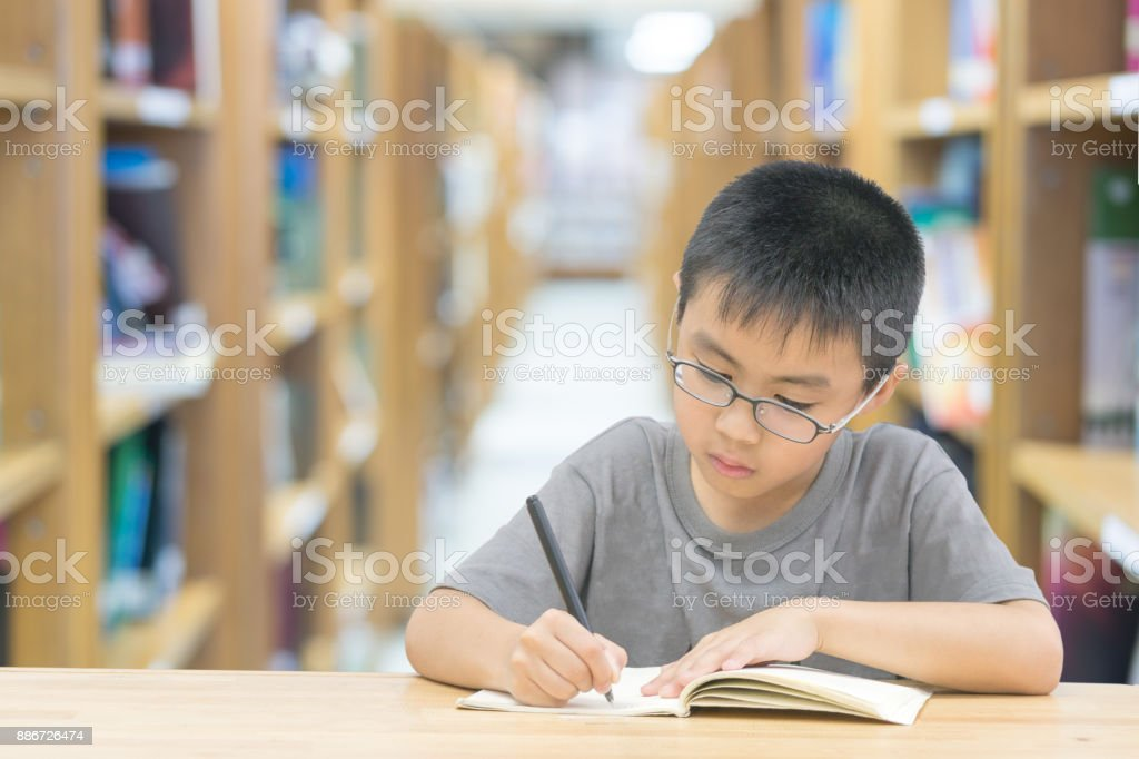 asian children Write a book in library room stock photo