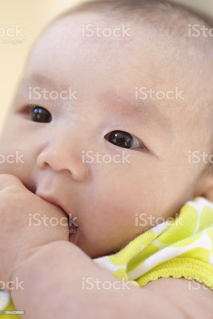 Asian Chinese 3 months Old Baby Girl Sucking Her Thumb royalty-free stock photo