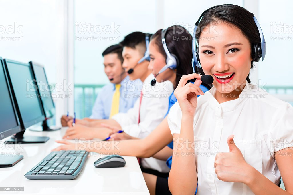 Asian Chinese call center agent team on phone stock photo