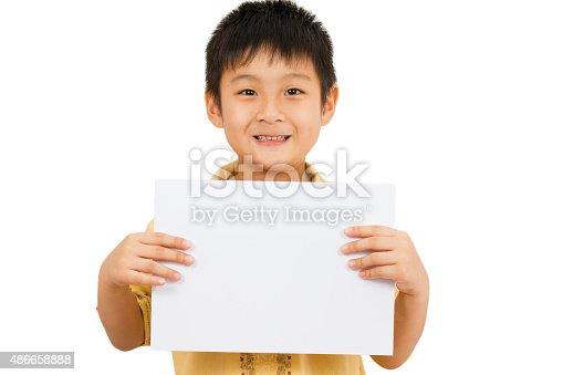 istock Asian Chinese Children Holding blank white board. 486658888
