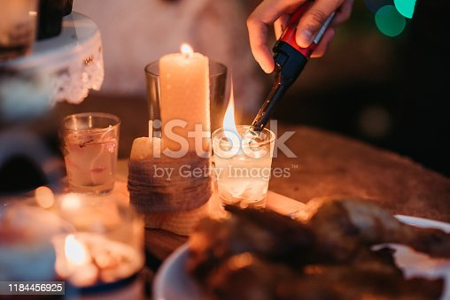 Light up the candle, prepare pinecone wreath, roast chicken, cup cake and foods for christmas party