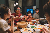 istock asian chinese family and cousins having reunion dinner at home 1297931559