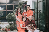 asian chinese family celebrating chinese new year looking at camerafor best wishes, luck , prosperity and health