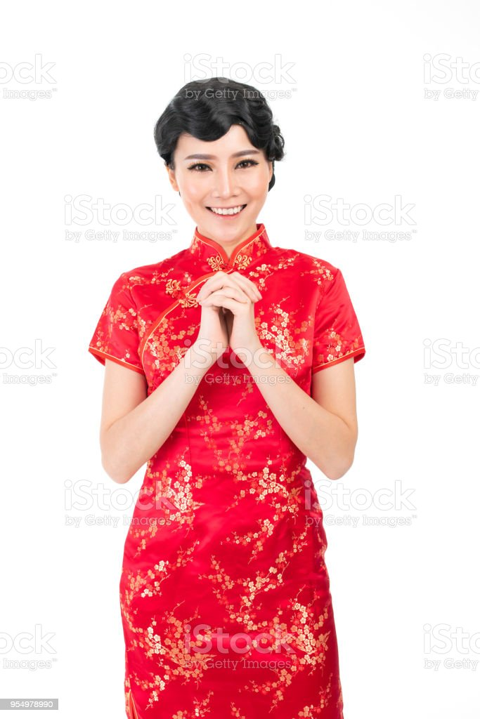 Asian chinese in traditional chinese dress cheongsam with a chinese asian chinese in traditional chinese dress cheongsam with a chinese new year greeting gesture royalty m4hsunfo