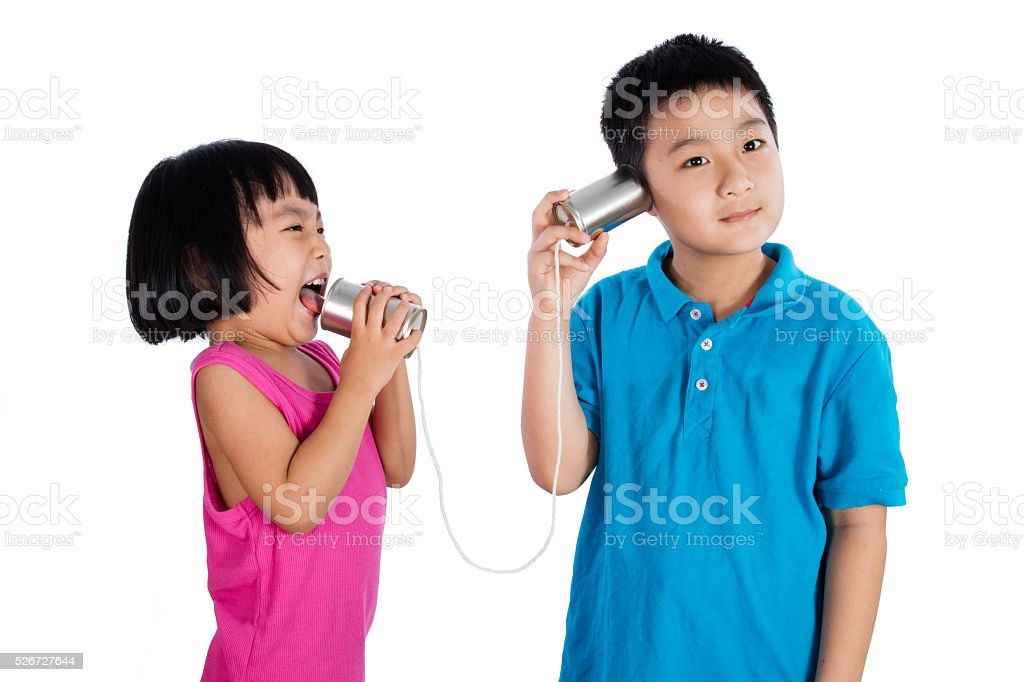 Asian Chinese Kid Playing with Tin Can Phone stock photo