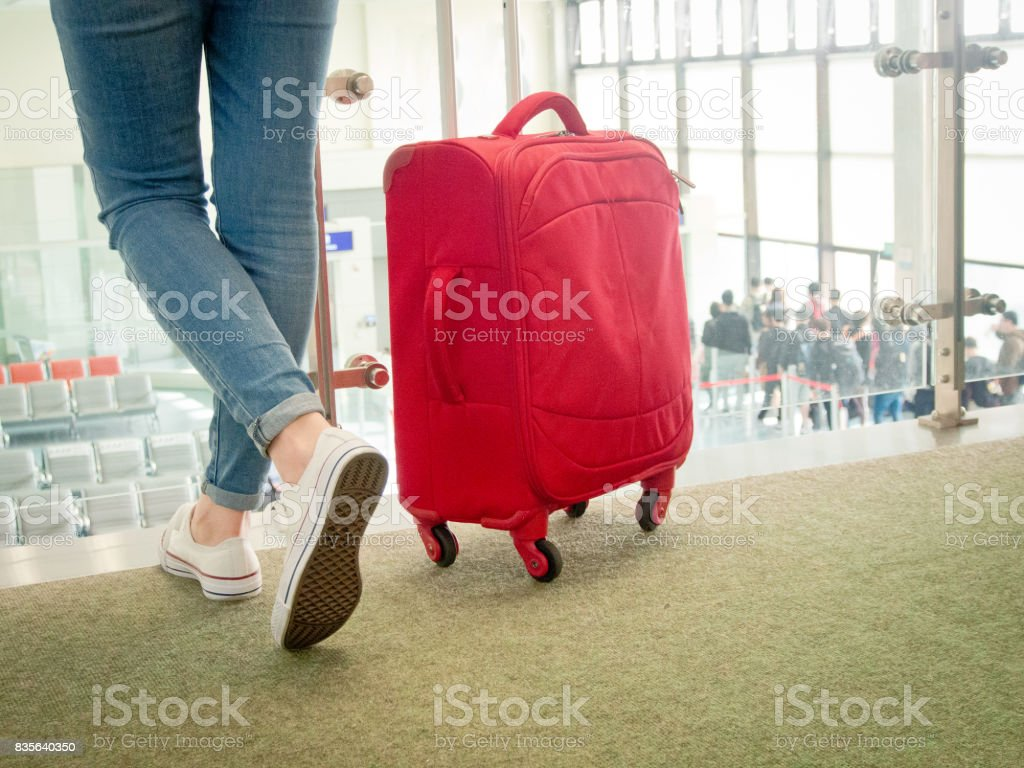 asian chinese lady wearing jeans and white shoes stock photo