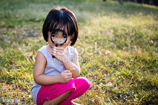 istock Asian Chinese Little Girl Exploring With Magnifying Glass 610678198