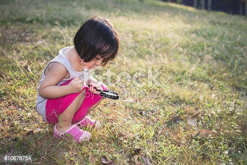 istock Asian Chinese Little Girl Exploring With Magnifying Glass 610678754