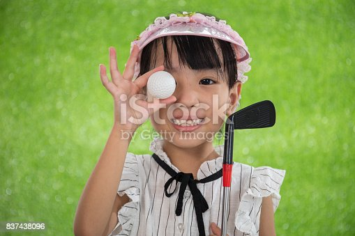 istock Asian Chinese little girl holding a golf ball 837438096