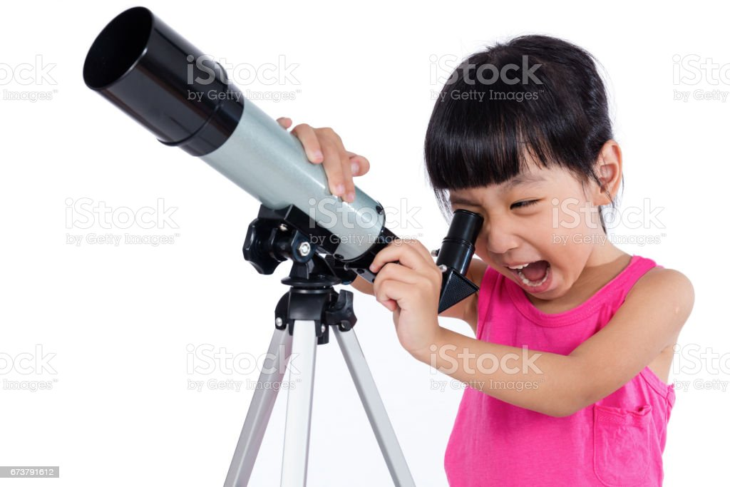 Asian Chinese little girl holding a telescope stock photo