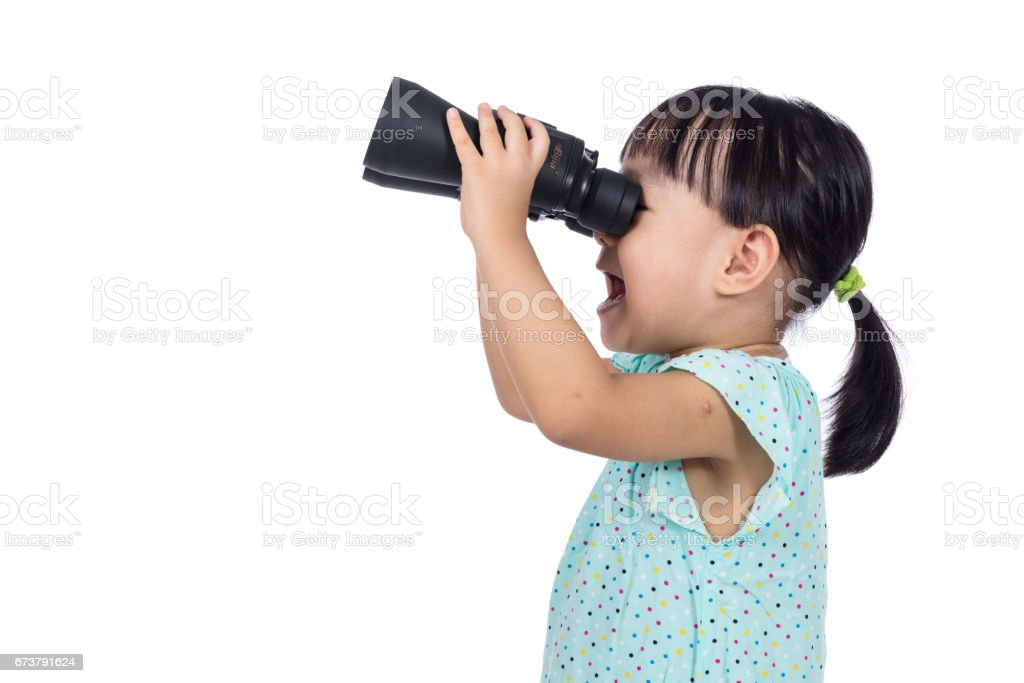 Asian Chinese little girl holding binoculars royalty-free stock photo
