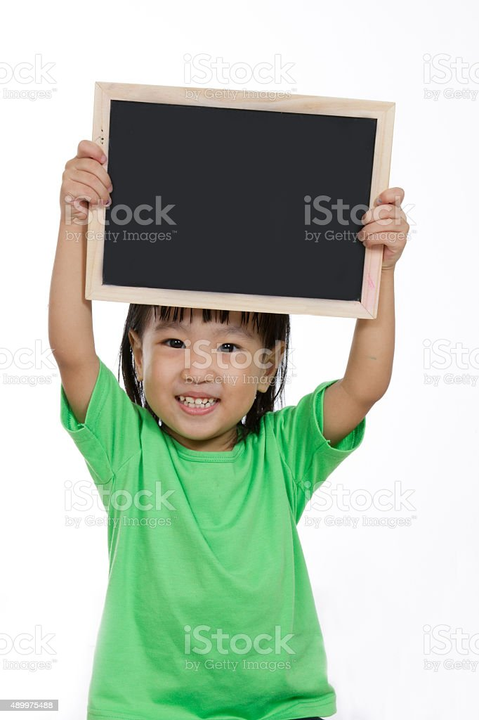 Asian Chinese little girl holding chalkboard stock photo