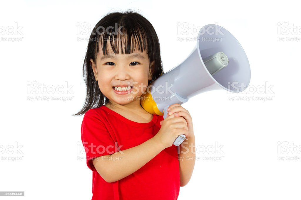 Asian Chinese little girl holding megaphone stock photo