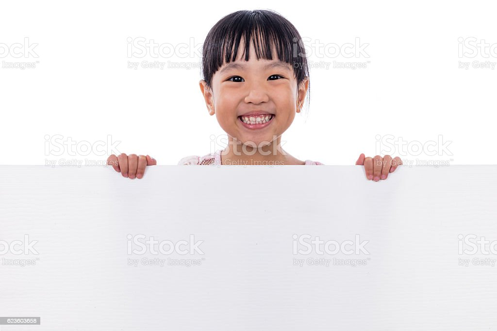 Asian Chinese little girl holding white board stock photo